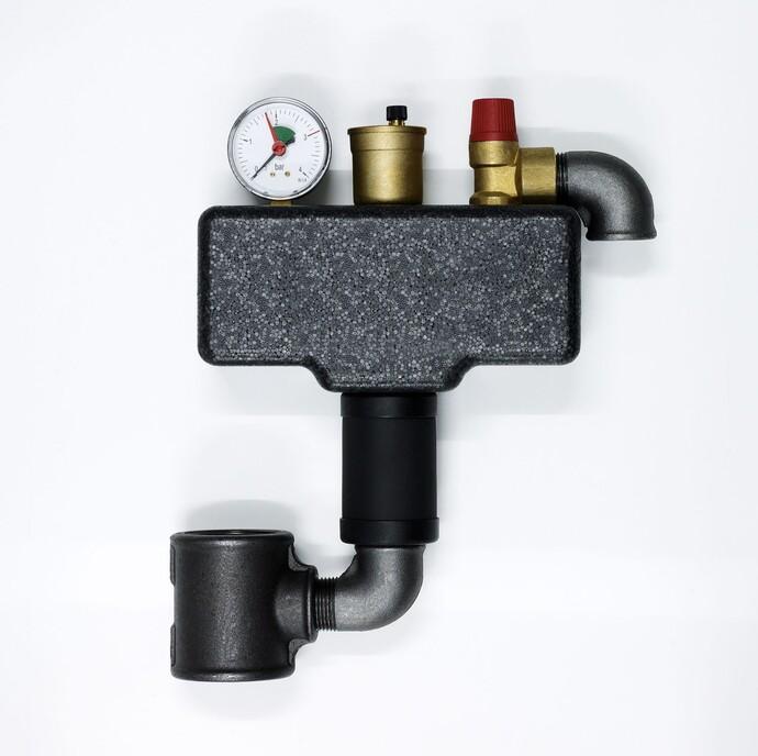 Bei unserem ecoCRAFT Brennwertsystem ist die Sicherheitsgruppe kompakt in einem isolierten Block zusammengefasst.